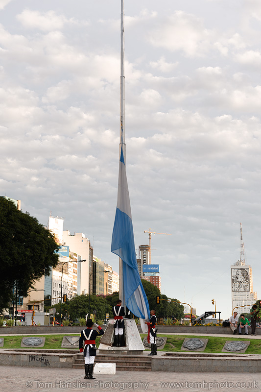 Taking the flag down for the night at Plaza de la República, Buenos Aires.